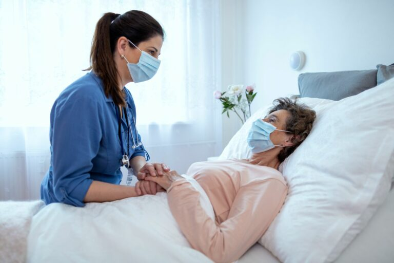 Home caregiver comforting a patient at home