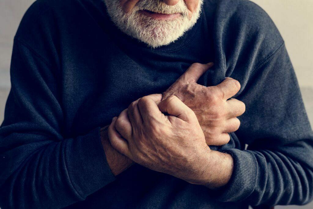Close up of man having a heart attack
