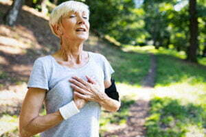 Senior woman exercising outdoors to prevent cardiovascular diseases and heart attack