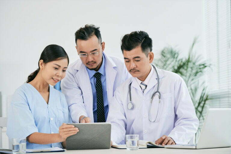 Nurse and doctors checking fusion of data
