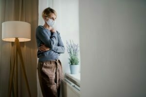 Woman with depression at home during covid-19