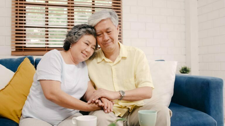 Elderly couple with healthy heart at home