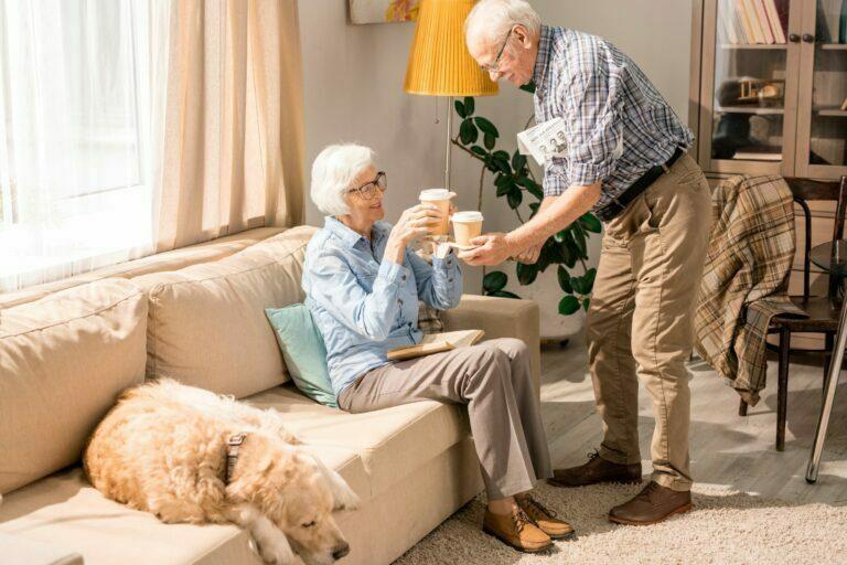 senior couple drinking coffee with sweeteners