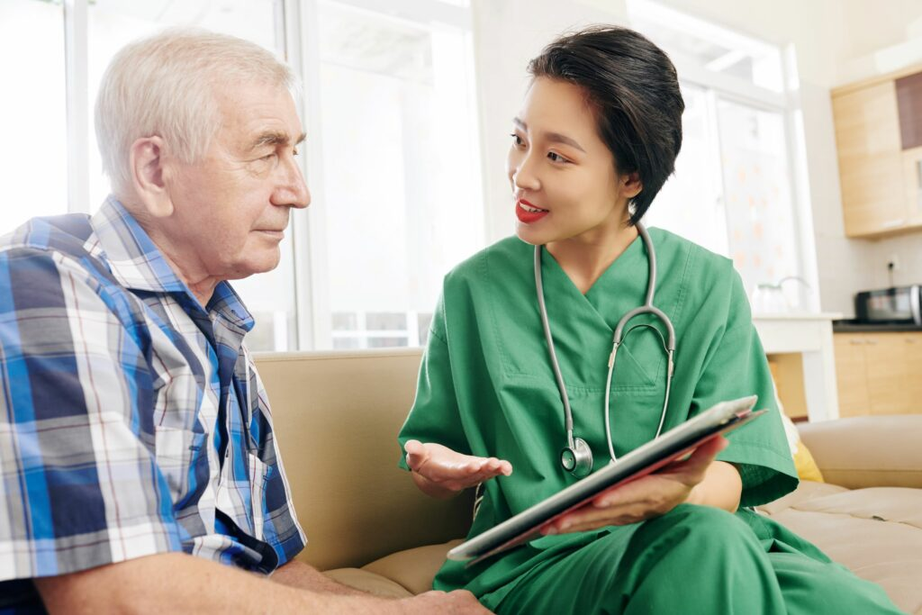 Nurse visiting a patient enrolled in hospital care at home program